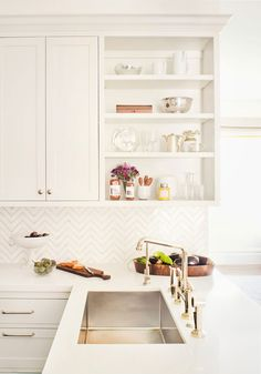 Open shelves and chevron tile