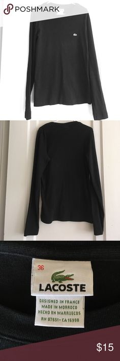 Black Lacoste shirt Basic black Lacoste tshirt that's hardly been worn! Size 36, runs small. High quality, keeps its shape and true black color well. A closet staple! Lacoste Tops Tees - Long Sleeve