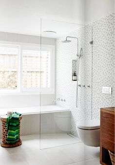 Entryway Decor Ideas Modern White tile bathroom with glass shower.Entryway Decor Ideas Modern White tile bathroom with glass shower White Bathroom Tiles, Bathroom Renos, Laundry In Bathroom, Bathroom Ideas, Wet Room Bathroom, Bath Room, Gray Tiles, Small Bathroom Layout, Bathtub Ideas