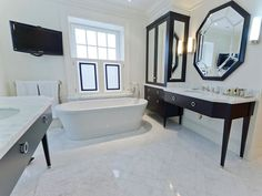 bathrooms - TV freestanding tub black mirrored cabinet armoire glossy black octagon mirror elegant black bathroom vanity marble top freestanding tub marble tiles