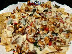 What do you get when you combine the cheese and tortilla chips of nachos with the chicken, onions, and peppers of fajitas? Chicken Fajita Nachos!!! Perfect as an appetizer for the big game or as a light, different main course!!