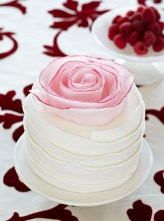 Beautiful Ruffle Frosted Cake With Pink Floret Tipped With Raspberry