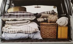 All packed with blankets for a roadtrip! Aztec geometrical designs and handwoven artisan basket in trunk of vintage VW Volkswagen bus Van with friends to explore and adventure into the organic nature wild travel wanderlust