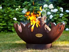 Appropriately named Blaze, this fire pit made of recycled steel will have flames flickering through the...flames. Made by  Fancy Fire Pit .