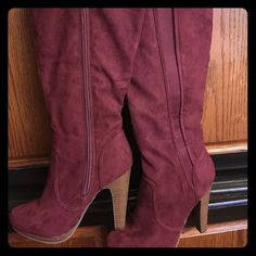New Burgundy suede boots The top of boot at knee to the platform is 19 inch long . Has a elastic frown the side to help with width . The platform and heels are brown and tan stripes . Has a 4 1/2 inch heel .also has like a pad on insole on bottom of boot to help with grip. Has a 14 inch zipper in boot . Shoes