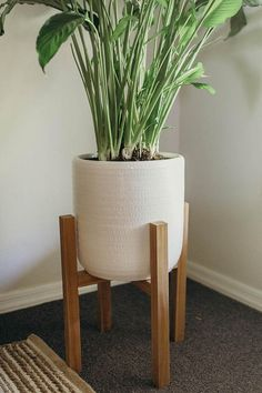 **CURRENT SHIPPING/PROCESSING TIME IS 2-3 WEEKS BECAUSE WE WILL BE ON VACATION THE 8TH-16TH** **DUE TO THIS INCONVENIENCE HERE IS A 5% COUPON CODE ON YOUR ORDER!! CODE: SUMMER5 **   This beautiful mid century style plant stand is the perfect decor piece for any room. Made from locally sourced wood.   ****Ceramic pot not included****  Color:  We offer these stands in many stain or paint options. See the listed picture of numbered stain selections. Contact us with a specific color if i...