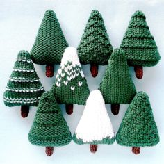 Christmas Trees 1 Knitting pattern by Squibblybups - Christmas Knitting - Nine different Christmas trees which can be left as they are or decorated. The trees are knit flat - Christmas Tree Knitting Pattern, Knit Christmas Ornaments, Christmas Crafts, Knitted Christmas Decorations, Christmas Ideas, Crochet Christmas, Christmas Lights, Modern Christmas, Handmade Decorations