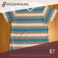 CHAMPS striped v-neck tee V-neck tee in teal, grey, and white from Champs.           Hi! 🙋🏻 Check out my closet for others great items! ✨ Our family is moving 🏡, and as such we'll be clearing out our closets🚪!!! Make sure to bundle 🛍 for a discount! 💁🏻 Champs Shirts Tees - Short Sleeve