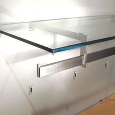 The rPUC standard rectangular ferrule system from PEERLESS DESIGNS, with stainless steel BLADE fittings, for shelving and displays. Deceptively neat in appearance, rPUC offers a surprising secure option for heavier fashion merchandising or other merchandise.