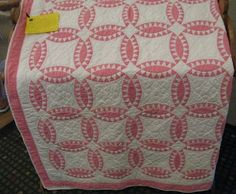 Well I just have to make a pink and white quilt like this someday. The pattern is Pickle Dish.