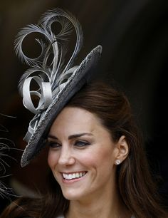 Hats in the British tradition, hot glued to the side of your head (how else do you explain it staying?)
