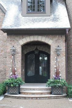 This entrance is quite charming! Love that the porch is covered enough for guests waiting at the door to be clear of the elements; such hospitality! :)