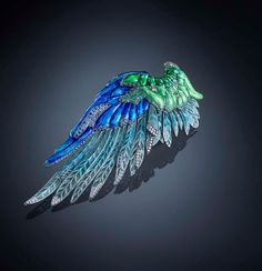 Luz Camino wing brooch, set with sapphires, emeralds and acquamarines in enamelled gold and silver