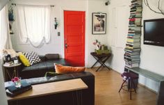 I love everything about this room from the stacked bookcase to the bright door!