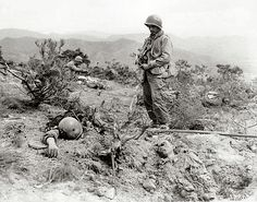 08 I found this image from the Korean War at  http://www.koreanwaronline.com/history/Appleman/Frames/SC349306.htm along with a brief story.  I wonder what Sgt. Herbert was thinking as he looked upon the lifeless body of this dead communist soldier.  Did he feel a victor?  A conqueror, defending a nation, an ideal?  Did he feel at peace?  Or does he wonder when someone will be standing over his body, contemplating these very things?