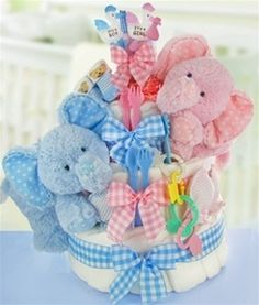 Adorable Gingham Elephant Twins 3 Tier Diaper Cake Celebrating the arrival of twin babies? This adorable super sized gingham elephant themed diaper cake will make an amazing presentation and / or centerpiece at the baby shower! $108.95 Free Shipping (http://www.blueberrycreekgiftbaskets.com/adorable-gingham-elephant-twins-3-tier-diaper-cake/)