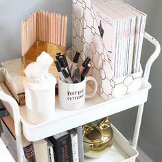 A bar cart can double as a pretty way to organize desk supplies