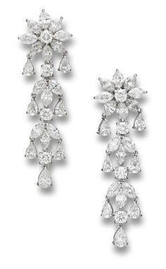 A pair of diamond pendant earrings Each suspending a cascade of brilliant, marquise and pear-shaped diamonds, to a flowerhead surmount set with similarly-cut diamonds, mounted in platinum, the diamonds estimated to weigh approximately 14.60 carats in total, earring length 5.7cm