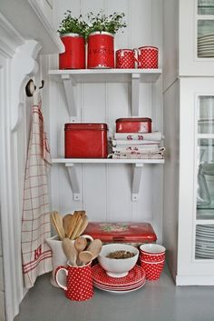 Like this kitchen colour scheme.  White kitchen cabinets, pale grey splashback/counter with red accessories