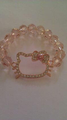 rose hello kitty bracelet by ArmCandyByNonie on Etsy, $11.00