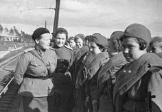 """""""Before leaving for the front"""". Head of the Central Sniper School's political department talks to girls leaving for the front."""