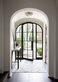 Fabulous black steel doors connect inside and outside at Sugar Creek by Ryan Street & Associates