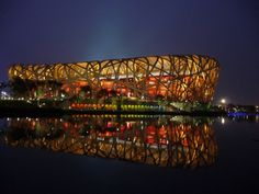 Built in China, the Bird's Nest stadium served as the host for the 2008 Summer Olympics and Paralympics. Designed primarily by architects Jacques Herzog and Pierre de Meuron, the marvel boasts a bowl-shaped composite of a red concrete seating area and an outer steel frame that encloses it.