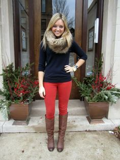 red jeans, sweater and boots. I would def go with a real fur collar though, blah faux fur. Warm, practical and awesome.