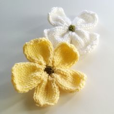Knitted Dogwood Blossoms Petals CO 5 sts.  Row 1 (WS): purl. Row 2: [m1, k1] x5. (10 sts) Row 3: purl. Row 4: k1, m1, k7, m1, k2. (12 sts) Row 5: purl. Row 6-15: Work in  stockinette stitch. Row 16: k1, sk2p, k4, k3tog, k1. (8 sts) Row 17: purl. Row 18: k1, sk2p, k3tog, k1. (4 sts) Row 19: purl.  Bind off knitwise.  Repeat the pattern three more times for four petals.
