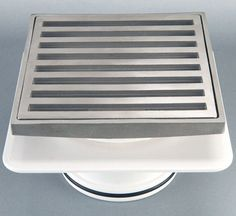 Square on square floor grate $79 @ Bathroom Warehouse