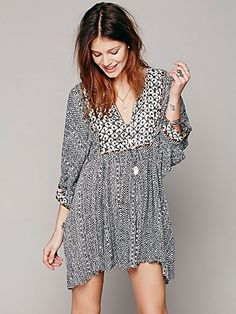 FP ONE Mix Print Tunic- love this long tunic with asymmetrical hem over jeans.