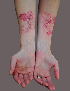 Beautiful light flower tattoos but I wouldn't get them on the forearm.