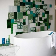 Inspiration from Bathrooms.com: We love this patchwork effect - perfect for an eclectic room. Pick a main colour theme (green and white here), then one other accent (turquoise here) to create a unique effect. #bathroom #tiles #wetrooms #designideas