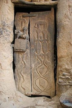 brown - door - Mali - Africa - Dogon door with a carved door lock depicting a man on a horse (could also be a donkey).