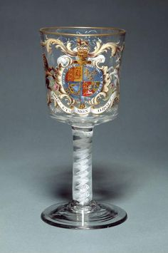 Glassware to show support for the royal family: Drinking glass by William Belby, c 1762. The decoration suggests that the gobelet celebrated the birth of the Prince of Wales, the future George IV, in 1762. Fitzwilliam Museum.