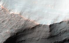 Alluvial fans are gently-sloping wedges of sediments deposited by flowing water. Some of the best-preserved alluvial fans on Mars are in Saheki Crater, an area that has been imaged many times previously.  This observation, captured on Jan. 23, 2016 by the High Resolution Imaging Science Experiment (HiRISE) camera on NASA's Mars Reconnaissance Orbiter, covers two impact craters that expose the stratigraphy of the fans.