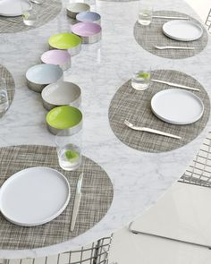 Woven from vinyl, these oval mini basket-weave mats provide a color-saturated backdrop for plates and wipe clean in a flash
