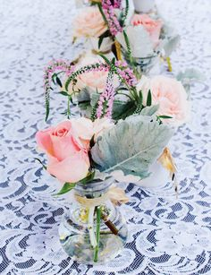 Pink and Gold Party Flowers with white lace tablecloth