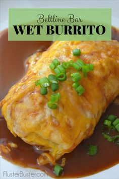 Beltline Bar Wet Burrito. Seasoned ground beef and beans wrapped in a flour tortilla, then it's topped with a very mild and flavorful sauce and lots of cheese. This is a great alternative for those that don't like the strong flavor of enchilada sauce. Simple, delicious recipe.