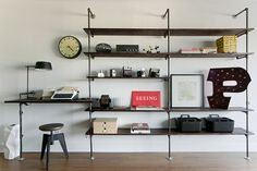 pipe shelving with desk. love the stool too...