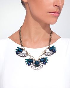 Looking for a fresh take on statement style? Mix it up with an edgy curb chain and vivid jewels inspired by peacock plumage