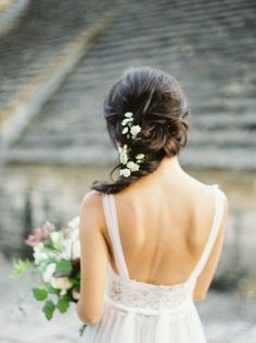 flowers in her hair | Penelope wedding dress by Watters for BHLDN | image via: style me pretty