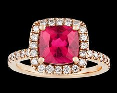 Rubellite Tourmaline Ring, 2.41 Carats~ A rare cushion-cut rubellite tourmaline with a richly saturated fuchsia hue is at the center of this ring. One of the most desirable of all tourmalines, the rubellite is cherished for its vibrant and rich color. Deriving its name from the ruby, this coveted stone displays an intense, deep coloration that shimmers under any lighting condition. Weighing 2.41 carats, this example is encircled by a halo of diamonds totaling 0.88 carat. ~M.S. Rau Tourmaline Ring, Rare Gemstones, Alexandrite, Cushion Cut, Peridot, Hue, Garnet, Heart Ring, Diamonds