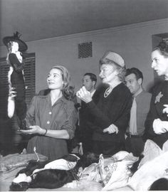 Eliane Bonabel showing a Théâtre de la Mode doll dressed by Balmain to Carmel Snow and Diana Vreeland, New York, 1946.