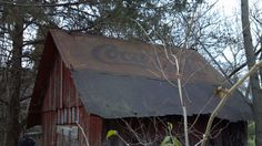 Abandoned barn with old Coca Cola sign for roofing!