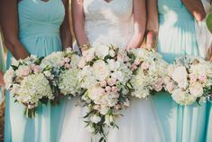 Bridal bouquets with white hydrangea, white lisianthus, and blush spray roses, cascade style.