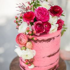 From the The Grounds Wedding Cake archive; this beautiful pink, semi naked cake is adorned with ranunculus, roses and other assorted floral. Perfect for spring/summer time weddings. Let us know your favourite flavour of cake!