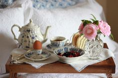 Breakfast in Bed with soft pink flowers and blue and white tea time china - lovely!