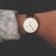 Clock and Awe - simple, bold-faced leather watch by Daniel Wellington.