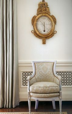 Single Chair and Gold Clock